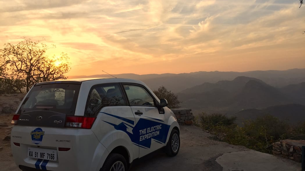 A REVA EV backed by a sunset during the Mahindra Electric Expedition.