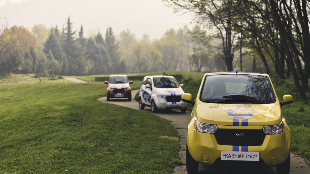 Three REVA EVs on a path during the Mahindra Electric Expedition.
