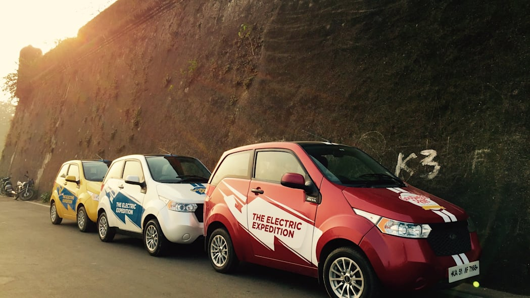 Three REVA EVs lines up during the Mahindra Electric Expedition.