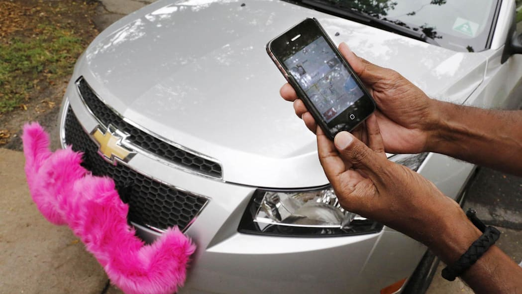 The Lyft app allows users to request a ride in Miami on June 4, 2014. Regulators across the U.S. and in Europe are struggling with how to control the digital-dispatch services that have upended the transportation business. © Jose A. Iglesias/Miami Herald/MCT/Alamy Live News