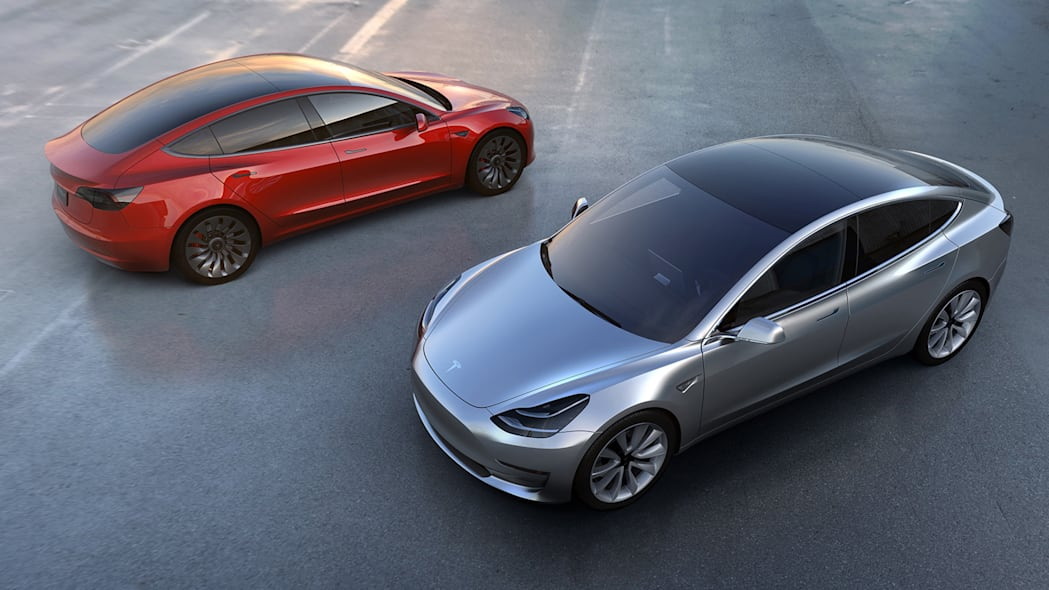 tesla model 3 red and silver above