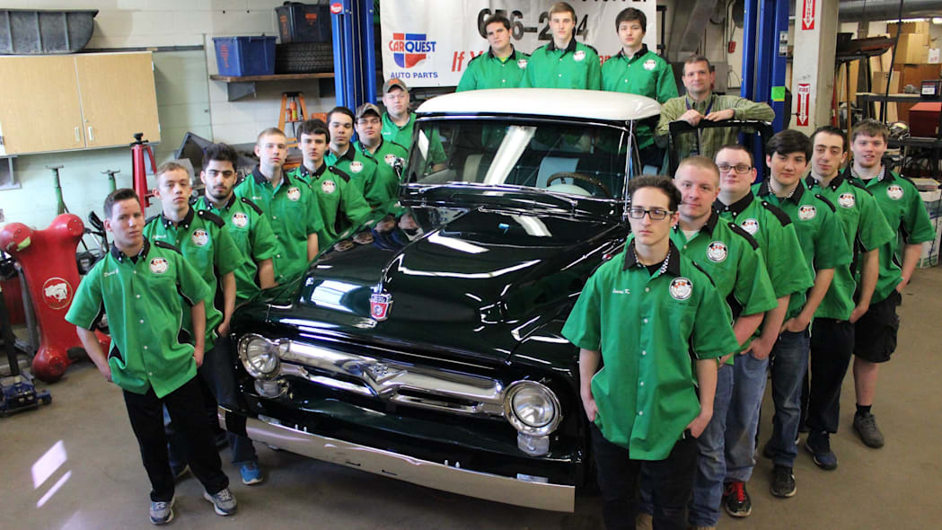Students pose next to the finished '56 Ford truck.