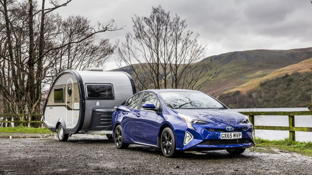 2016 Toyota Prius with trailer front 3/4 static