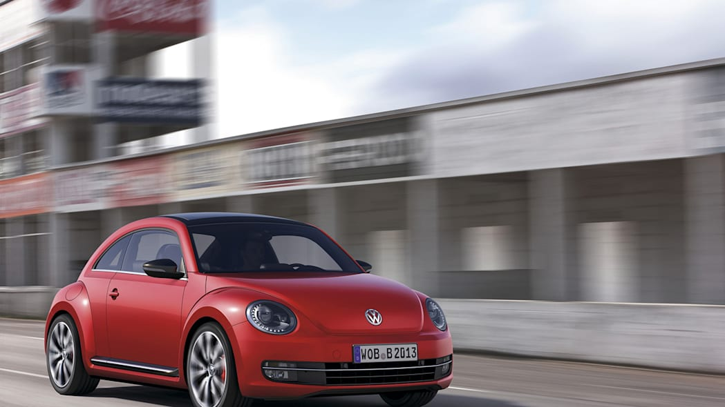 2012 Volkswagen Beetle in red, exterior in motion