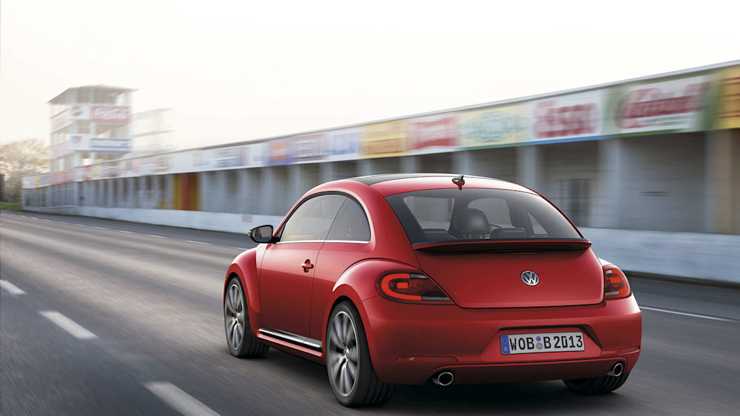 2012 Volkswagen Beetle in red, rear exterior in motion