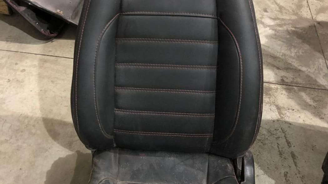 This July 15, 2019 photo released by Itajai Civil Police shows the seat of a car embroidered with a fake Ferrari logo,  inside a workshop in Itajai, Brazil. Brazilian police dismantled the clandestine workshop run by a father and son who assembled fake Ferraris and Lamborghinis to order, in Brazil's southern state of Santa Catarina. (Itajai Civil Police via AP)