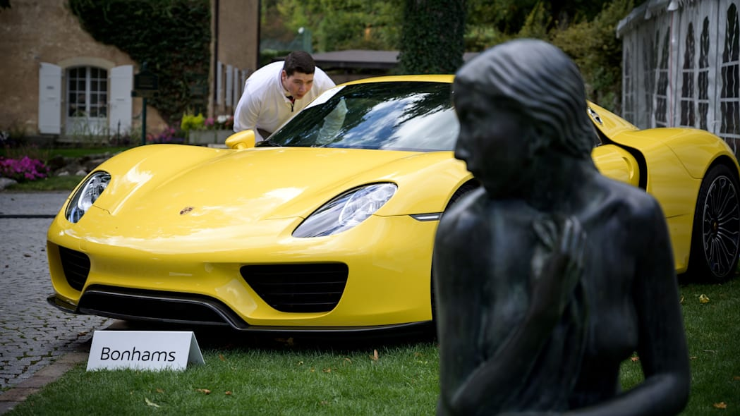 A picture taken on September 28, 2019 at the Bonmont Abbey in Cheserex, western Switzerland shows a 2015 Porsche 918 Spyder model car during an auction preview by sales house Bonhams of sport cars belonging to the son of the Equatorial Guinea's President. - A collection of luxury cars seized from Equatorial Guinea's vice president Teodorin Obiang Nguema will be auctioned off in Switzerland on September 29, 2019 and are estimated to bring in 18.5 million Swiss francs. (Photo by FABRICE COFFRINI / AFP)        (Photo credit should read FABRICE COFFRINI/AFP/Getty Images)