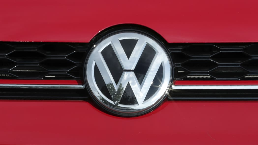 The Volkswagen logo on a Golf GTI catches a reflection of the sun at the Quirk dealership in Manchester, N.H., Wednesday, July 10, 2019. (AP Photo/Charles Krupa)