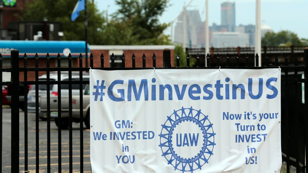 A sign hangs on the fence outside of United Auto Workers (UAW) Local 22 that wants General Motors to invest in them on September 15, 2019 in Detroit, Michigan. - Local UAW leaders from across the nation met Sunday morning in Detroit after the 2015 General Motors collective bargaining agreement expired Saturday night and opted to strike at midnight on Sunday. (Photo by JEFF KOWALSKY / AFP)        (Photo credit should read JEFF KOWALSKY/AFP/Getty Images)