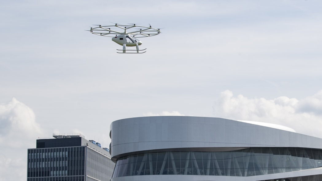 The volocopter, an electrically powered drone taxi, flies near the Mercedes-Benz museum in Stuttgart, southern Germany, on September 14, 2019. - According to the manufacturer it is the first public flight of the Volocopter in a European city. (Photo by THOMAS KIENZLE / AFP)        (Photo credit should read THOMAS KIENZLE/AFP/Getty Images)