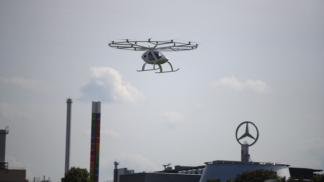 A prototype of an electrical air taxi that takes off and lands vertically (eVTOLs), made by German startup Volocopter, flies during a demonstration round at the Daimler museum in Stuttgart, Germany, September 14, 2019.  REUTERS/Michael Dalder
