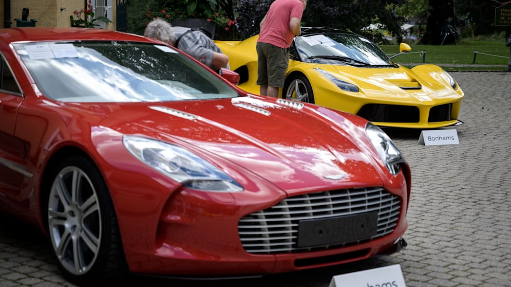A picture taken on September 28, 2019 at the Bonmont Abbey in Cheserex, western Switzerland shows a 2011 Aston Martin One-77 Coupe model car (L) and a 2015 Ferrari LaFerrari model car during an auction preview by sales house Bonhams of sport cars belonging to the son of the Equatorial Guinea's President. - A collection of luxury cars seized from Equatorial Guinea's vice president Teodorin Obiang Nguema will be auctioned off in Switzerland on September 29, 2019 and are estimated to bring in 18.5 million Swiss francs. (Photo by FABRICE COFFRINI / AFP)        (Photo credit should read FABRICE COFFRINI/AFP/Getty Images)