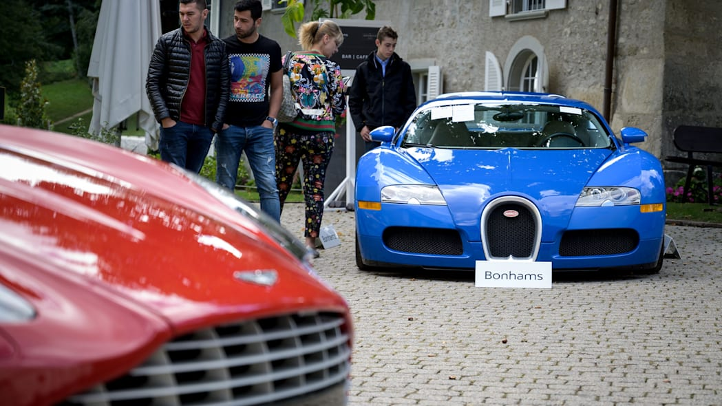 A picture taken on September 28, 2019 at the Bonmont Abbey in Cheserex, western Switzerland shows a 2010 Bugatti Veyron EB 16.4 Coupe model car (R) and a 2011 Aston Martin One-77 Coupe model car during an auction preview by sales house Bonhams of sport cars belonging to the son of the Equatorial Guinea's President. - A collection of luxury cars seized from Equatorial Guinea's vice president Teodorin Obiang Nguema will be auctioned off in Switzerland on September 29, 2019 and are estimated to bring in 18.5 million Swiss francs. (Photo by FABRICE COFFRINI / AFP)        (Photo credit should read FABRICE COFFRINI/AFP/Getty Images)