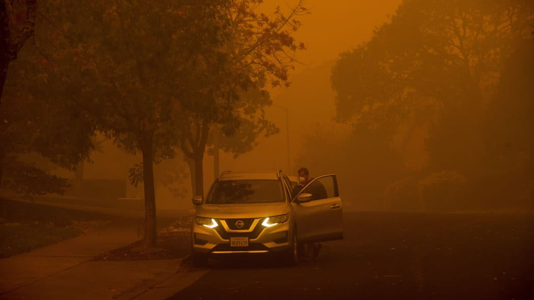 Smoke hangs over a residential neighborhood as a wildfire called the Kincade Fire burns in Healdsburg, Calif., Sunday, Oct. 27, 2019. (AP Photo/Noah Berger)