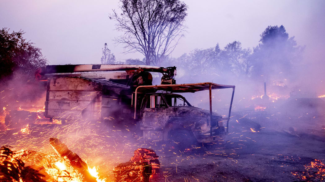 Flames from the Kincade Fire consume a truck in Healdsburg, Calif., on Sunday, Oct 27, 2019. (AP Photo/Noah Berger)