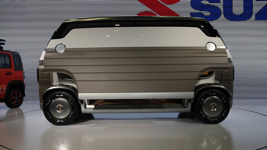 A Suzuki Hanare is displayed during the media preview of the Tokyo Motor Show Wednesday, Oct. 23, 2019, in Tokyo. (AP Photo/Kiichiro Sato)