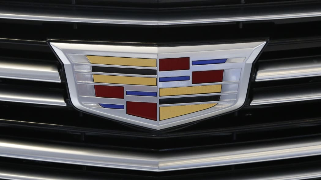 This is a the Cadillac logo on the grill of a Cadillac 2016 XT5 automobile on display at the Pittsburgh International Auto Show in Pittsburgh Thursday, Feb. 11, 2016. (AP Photo/Gene J. Puskar)