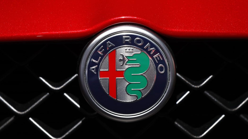 An Alfa Romeo logo is shown at the North American International Auto Show in Detroit, Monday, Jan. 14, 2019. (AP Photo/Paul Sancya)