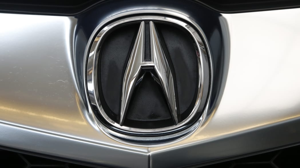 This is the Acura logo on the grill of an Acura 2018 ILX Tech Plus A-Spec model on display at the Pittsburgh Auto Show Thursday, Feb. 15, 2018. (AP Photo/Gene J. Puskar)