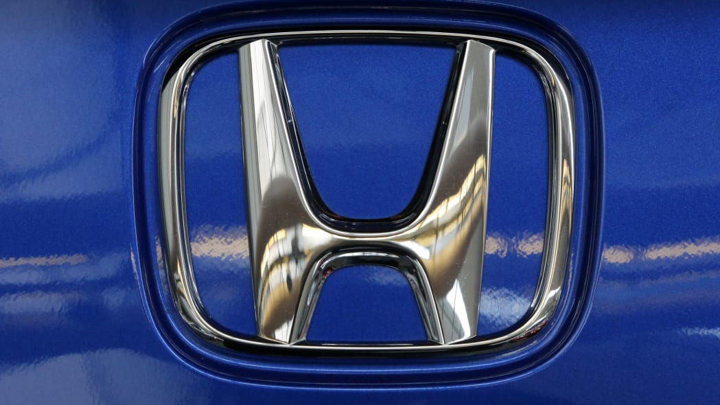 This is the Honda logo on the hatchback of a 2018 Honda Fit Sport on display at the Pittsburgh Auto Show Thursday, Feb. 15, 2018. (AP Photo/Gene J. Puskar)