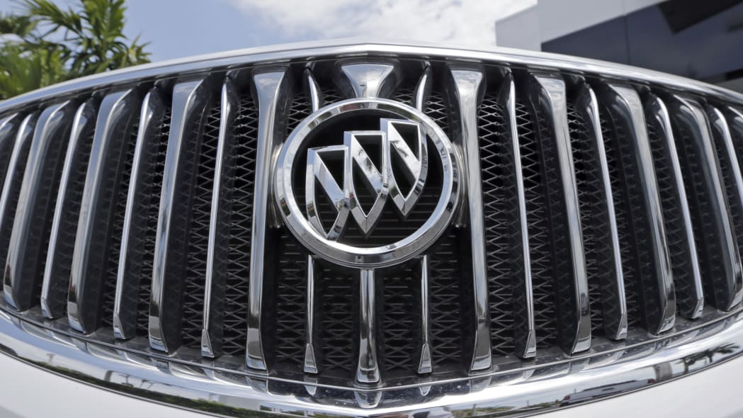In this photo taken Wednesday, April 26, 2017, shows the front grille of a 2017 Buick Enclave at a GMC Buick dealership in Miami. (AP Photo/Alan Diaz)