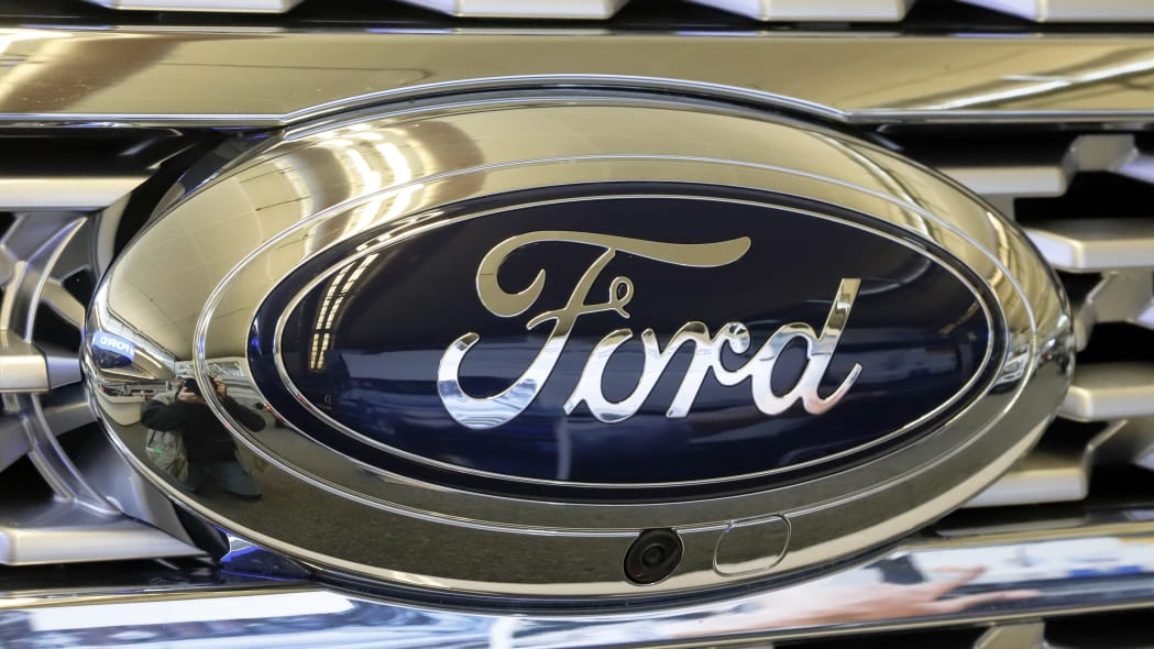 This is the Ford logo on the grill of a 2019 Ford Expedition 4x4 at the 2019 Pittsburgh International Auto Show in Pittsburgh Thursday, Feb. 14, 2019. (AP Photo/Gene J. Puskar)