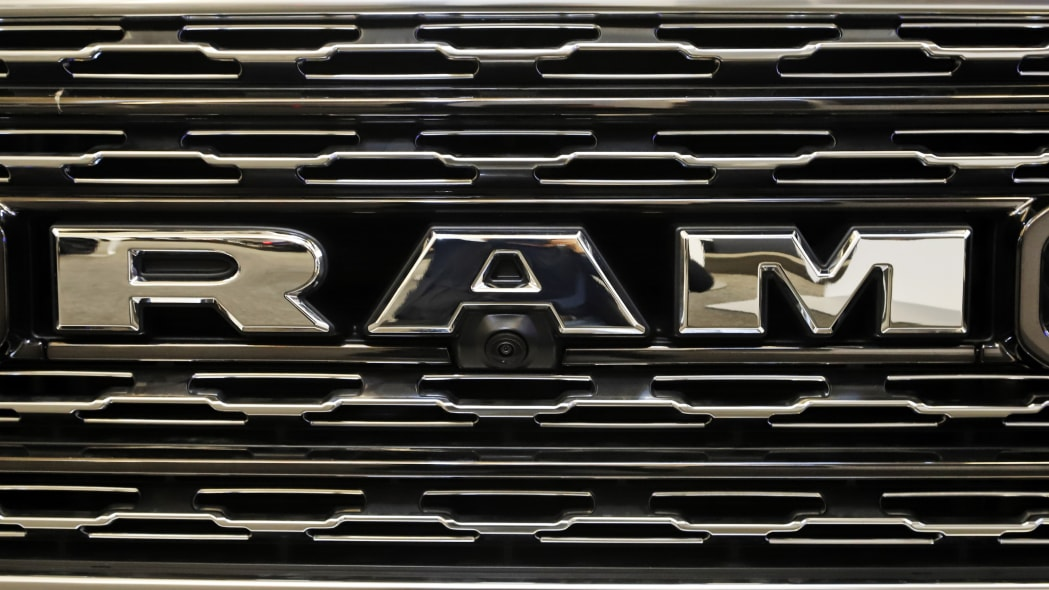 This is the front grill of a 2020 Ram 1500 Limited Crew Cab truck on display at the 2020 Pittsburgh International Auto Show Thursday, Feb.13, 2020 in Pittsburgh. (AP Photo/Gene J. Puskar)