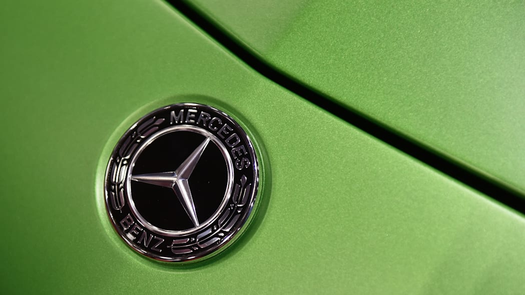 """LONDON, ENGLAND - MAY 17: A Mercedes Benz logo badge during the London Motor Show at ExCel on May 17, 2018 in London, England. The UK's largest automotive retail event will be showing over 150 new vehicles and includes a """"Built in Britain"""" display, Celebrating all that's great in British automotive engineering.  (Photo by John Keeble/Getty Images)"""