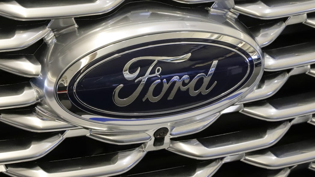 This is the Ford logo on the front grill of a 2019 Ford Explorer on display at the 2019 Pittsburgh International Auto Show in Pittsburgh Thursday, Feb. 14, 2019. (AP Photo/Gene J. Puskar)
