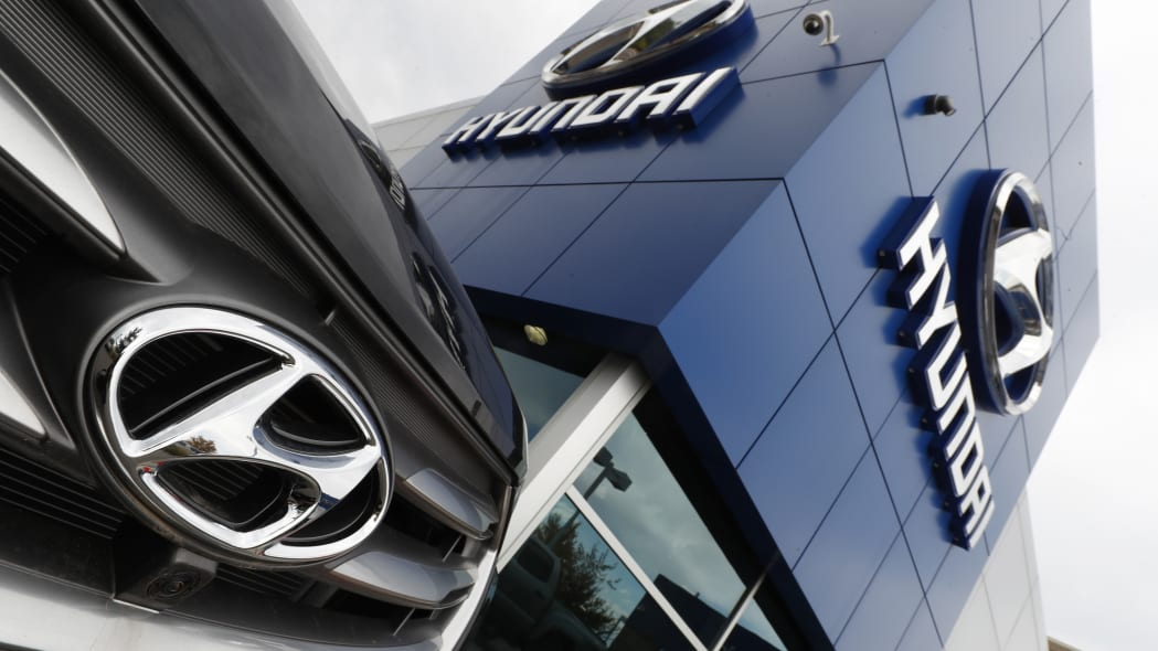 In this Friday, Oct. 6, 2017, the company logo shines off the grille of an unsold 2018 Santa Fe sports utility vehicle outside a Hyundai dealership in the south Denver suburb of Littleton, Colo. (AP Photo/David Zalubowski)