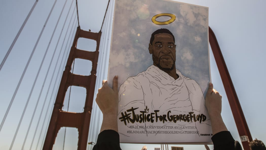 SAN FRANCISCO, CA- JUNE 6: A sign honoring George Floyd is held up on the Golden Gate Bridge in Francisco, California on June 6, 2020 after the death of George Floyd. Protestors climbed over the rails and demonstrated in the lanes causing a shutdown of South Bound traffic. Credit: Chris Tuite/ImageSPACE/MediaPunch /IPX