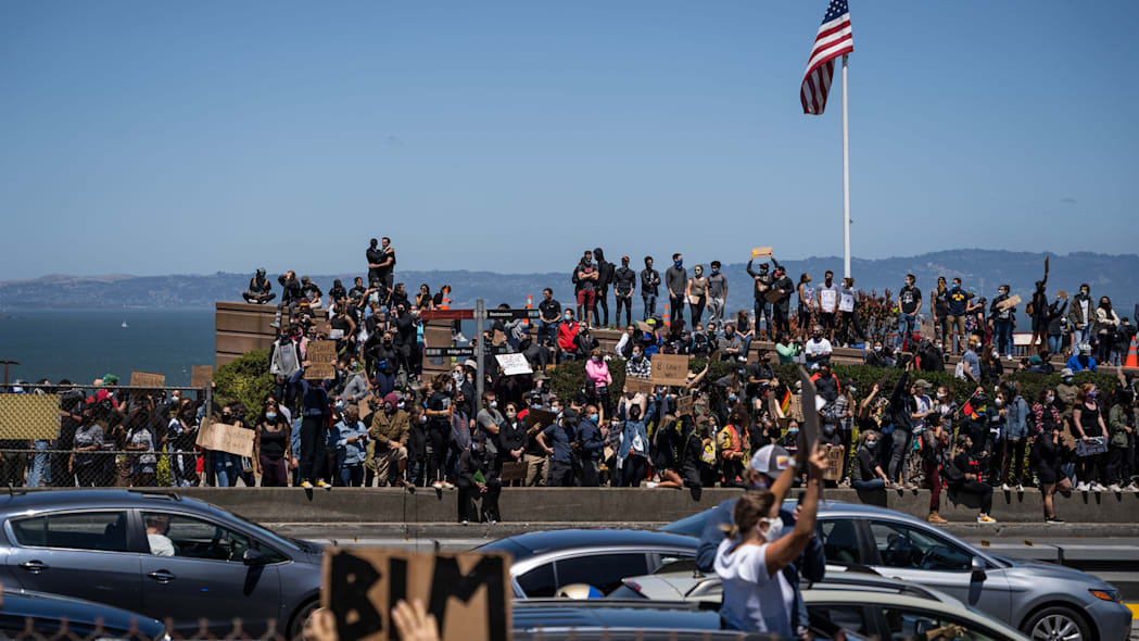 Protesters gather at the entrance to the Golden Gate Bridge during a demonstration against racism and police brutality in San Francisco, California, on June 6, 2020. - Demonstrations are being held across the US following the death of George Floyd on May 25, 2020, while being arrested in Minneapolis, Minnesota. (Photo by Vivian LIN / AFP) (Photo by VIVIAN LIN/AFP via Getty Images)