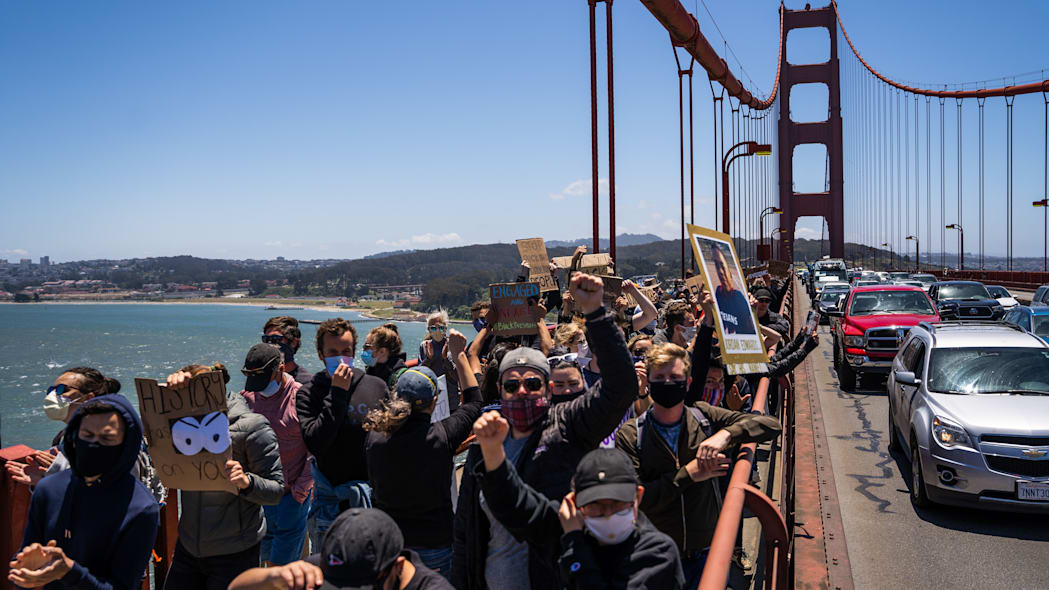 Protesters march across the Golden Gate Bridge during a demonstration against racism and police brutality in San Francisco, California, on June 6, 2020. - Demonstrations are being held across the US following the death of George Floyd on May 25, 2020, while being arrested in Minneapolis, Minnesota. (Photo by Vivian LIN / AFP) (Photo by VIVIAN LIN/AFP via Getty Images)