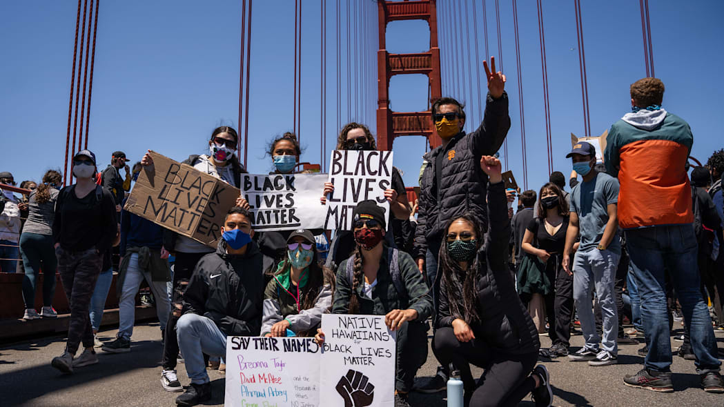 Protesters pose with Black Lives Matter signs on the Golden Gate Bridge during a demonstration against racism and police brutality in San Francisco, California, on June 6, 2020. - Demonstrations are being held across the US following the death of George Floyd on May 25, 2020, while being arrested in Minneapolis, Minnesota. (Photo by Vivian LIN / AFP) (Photo by VIVIAN LIN/AFP via Getty Images)