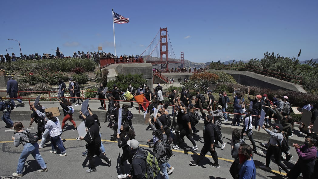Marchers walk to the Golden Gate Bridge in San Francisco, Saturday, June 6, 2020, at a protest over the Memorial Day death of George Floyd. Floyd died May 25 after being restrained by Minneapolis police. (AP Photo/Jeff Chiu)