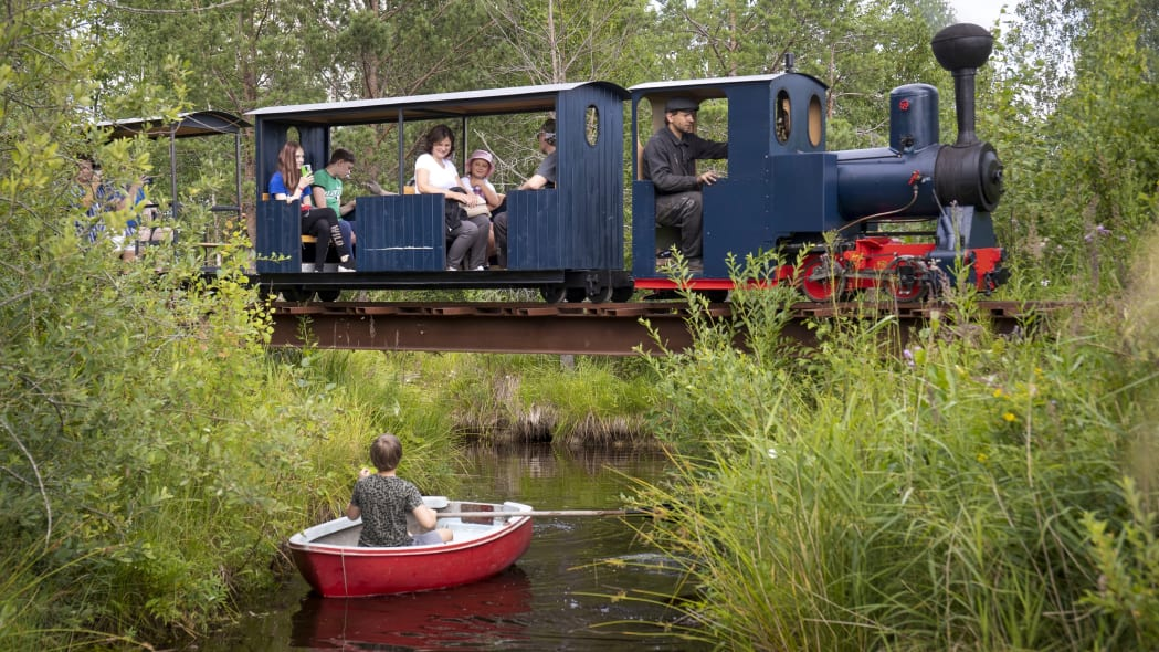 A miniature steam train runs across a bridge on Pavel Chilin's miniature personal narrow-gauge railway twisting through the grounds of his home in Ulyanovka village outside St. Petersburg, Russia Sunday, July 19, 2020. It took Chilin more than 10 years to build the 350-meter-long mini-railway complete with various branches, dead ends, circuit loops, and even three bridges.(AP Photo/Dmitri Lovetsky)
