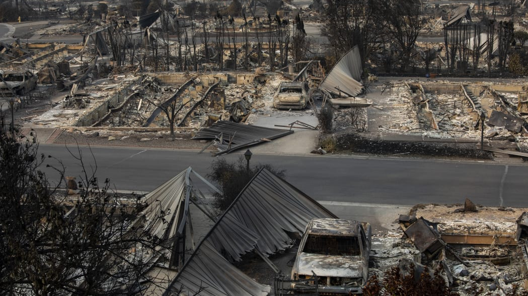 A neighborhood destroyed by fire is seen as wildfires devastate the region, Thursday Sept. 10, 2020 in Talent, Ore. (AP Photo/Paula Bronstein)