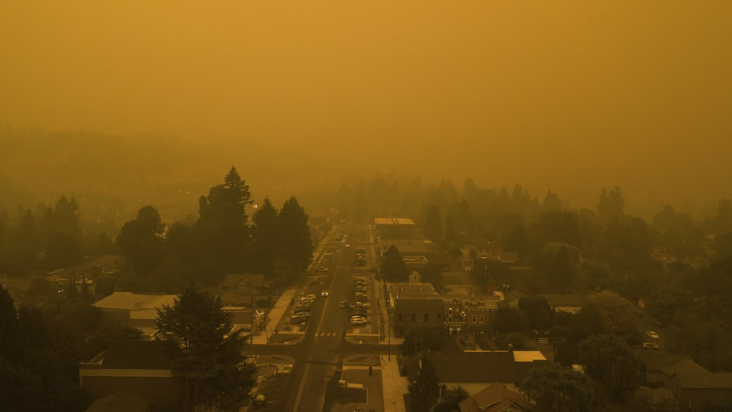Smoke from widlfires shrouds the town of West Linn, Ore., in this Christian Gallagher drone photo taken around 6 p.m. Thursday, Sept. 10, 2020. (Christian Gallagher via AP)