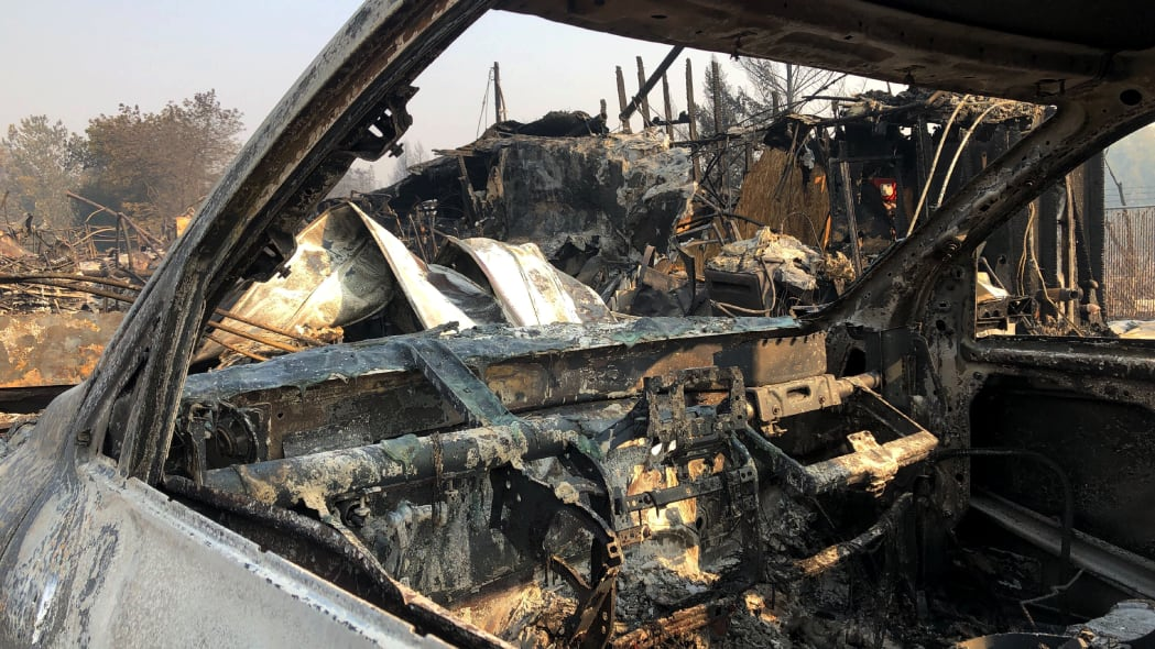 The interior of a vehicle is melted among the ruins of the Coleman Creek Estates mobile home park in Phoenix, Ore., Thursday, Sept. 10, 2020. The area was destroyed when a wildfire swept through on Tuesday, Sept. 8.. (AP Photo/Gillian Flaccus)
