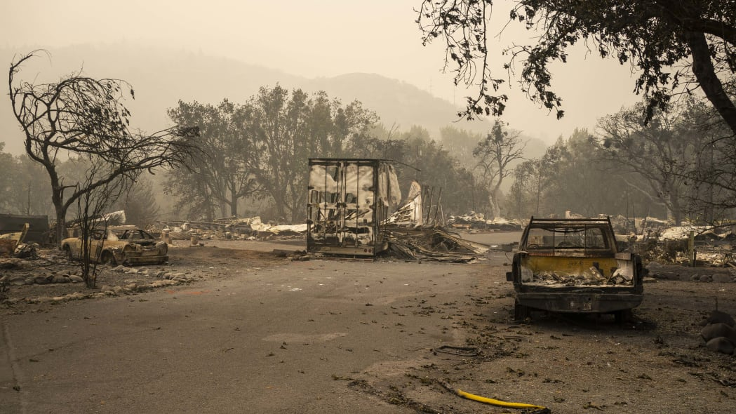 ASHLAND, OR - SEPTEMBER 11: Burnt automobiles and a fire hose sit in a mobile home park on September 11, 2020 in Ashland, Oregon. Hundreds of homes in Ashland and nearby towns have been lost due to wildfire. (Photo by David Ryder/Getty Images)