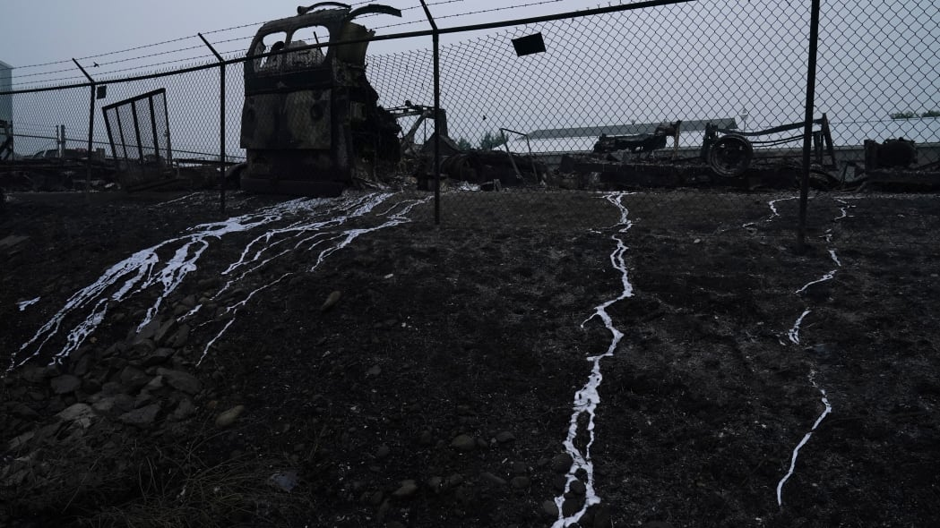 Metal melted from a truck by the Almeda Fire, is seen on a hill, Thursday, Sept. 10, 2020, in Talent, Ore. (AP Photo/John Locher)