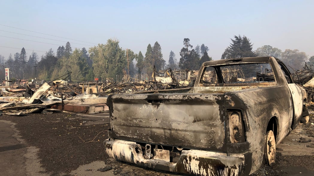 A charred pickup truck sits among the ruins of the Coleman Creek Estates mobile home park in Phoenix, Ore., Thursday, Sept. 10, 2020. The area was destroyed when a wildfire swept through on Tuesday, Sept. 8.. (AP Photo/Gillian Flaccus)