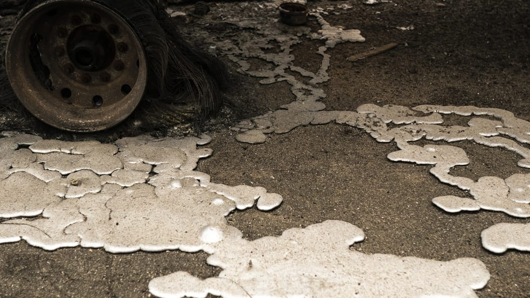 MOLALLA, OR - SEPTEMBER 10:  Melted metal on the ground at a burned out lumber yard on September 10, 2020 in Molalla, Oregon. Multiple wildfires grew by hundreds of thousands of acres Thursday, prompting large-scale evacuations throughout the state.  (Photo by Nathan Howard/Getty Images)
