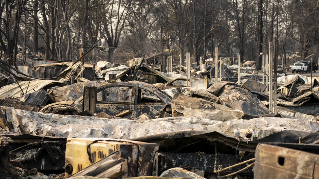 PHOENIX, OR - SEPTEMBER 10: Damaged homes and cars are seen in a mobile home park destroyed by fire on September 10, 2020 in Phoenix, Oregon. Hundreds of homes in the town have been lost due to wildfire. (Photo by David Ryder/Getty Images)