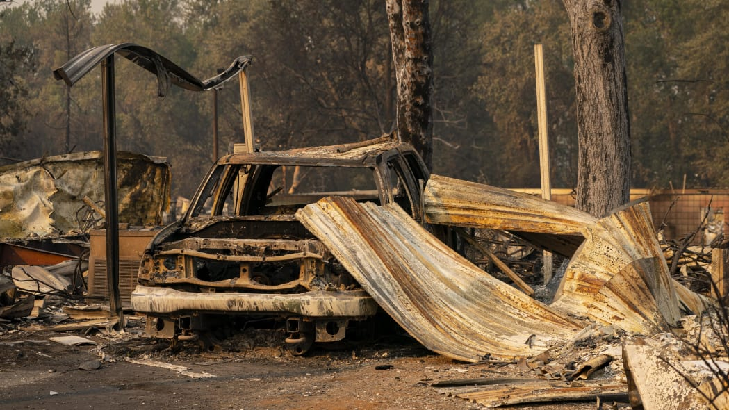 PHOENIX, OR - SEPTEMBER 10: A damaged home and car are seen in a mobile home park destroyed by fire on September 10, 2020 in Phoenix, Oregon. Hundreds of homes in the town have been lost due to wildfire. (Photo by David Ryder/Getty Images)