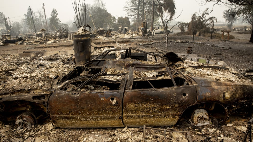 A neighborhood destroyed by fire is seen as wildfires devastate the region, Friday, Sept. 11, 2020 in Talent, Ore. (AP Photo/Paula Bronstein)
