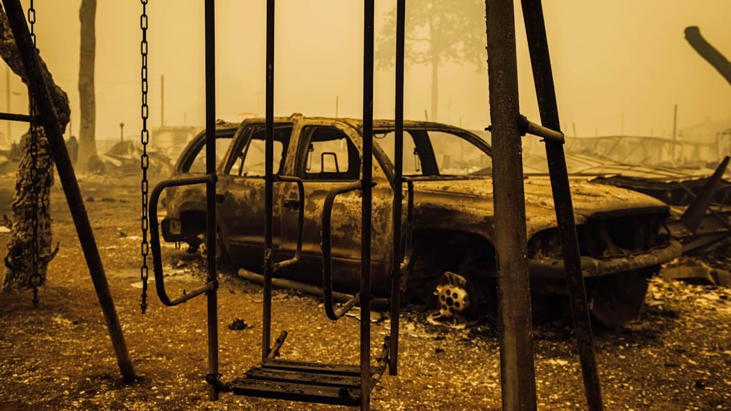A charred swing set and car are seen after the passage of the Santiam Fire in Gates, Oregon, on September 10, 2020. - California firefighters battled the state's largest ever inferno on September 10, as tens of thousands of people fled blazes up and down the US West Coast and officials warned the death toll could shoot up in coming days. At least eight people have been confirmed dead in the past 24 hours across California, Oregon and Washington, but officials say some areas are still impossible to reach, meaning the number is likely to rise. (Photo by Kathryn ELSESSER / AFP) (Photo by KATHRYN ELSESSER/AFP via Getty Images)