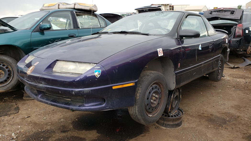 00 - 1996 Saturn SC in Colorado wrecking yard - photo by Murilee Martin