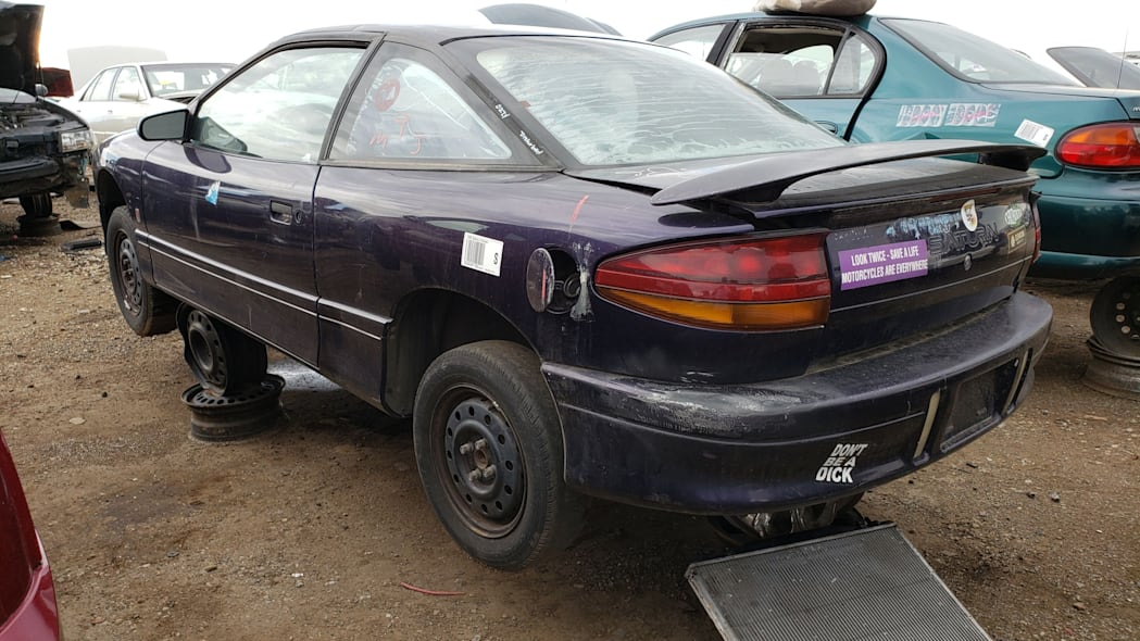 62 - 1996 Saturn SC in Colorado wrecking yard - photo by Murilee Martin