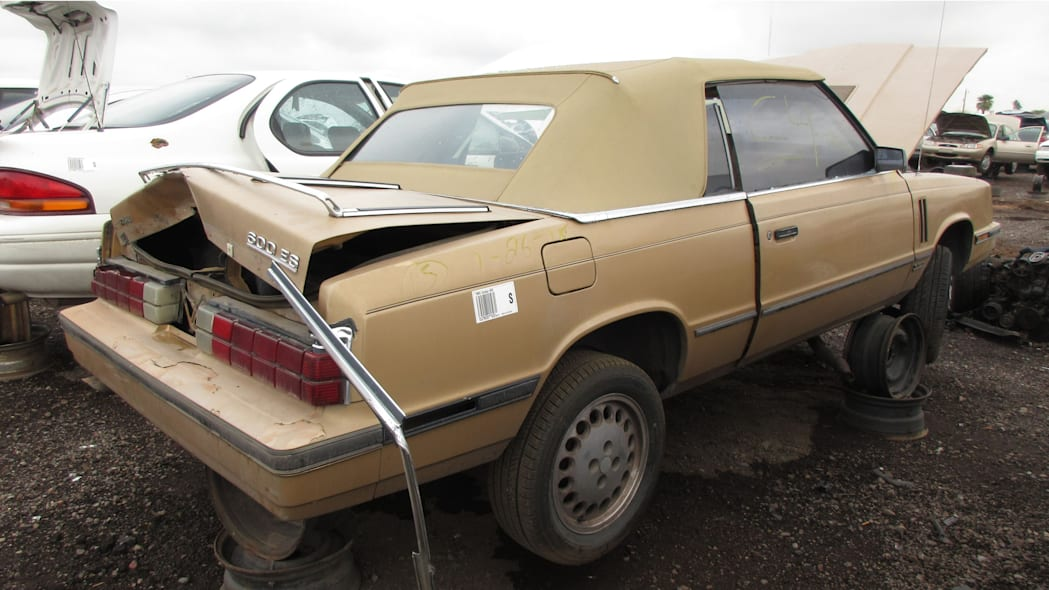 08 - 1985 Dodge 600 convertible in Arizona wrecking yard - photo by Murilee Martin